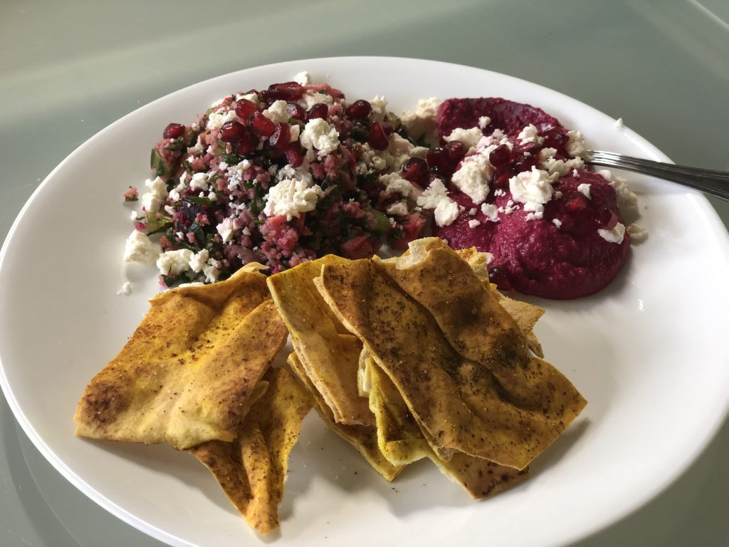 roasted root vegetable tabbouleh with beet hummus and pita crisps